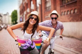 Happy expats cycling abroad