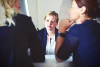 How Expats choose an accountant: Image of three businesswomen sitting at a table.