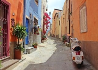 A small, colorful street in Italy