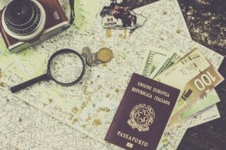 Schengen Visa: Picture of Italian passport and assorted currency