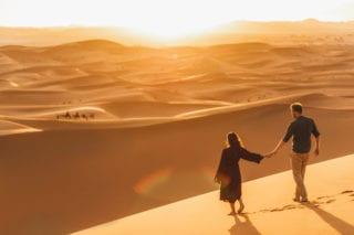couple walking in dubai in dessert