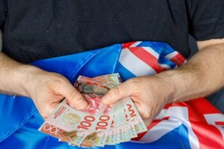 new zealand dollars spread out with flag